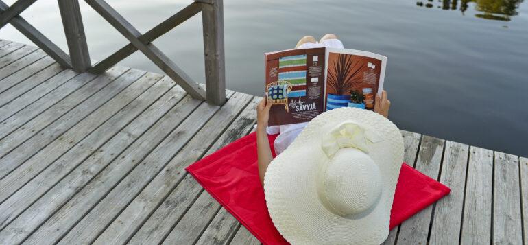 Girl reading magazine.